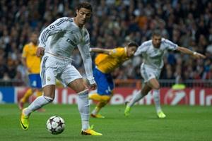 Cristiano Ronaldo runs in to score