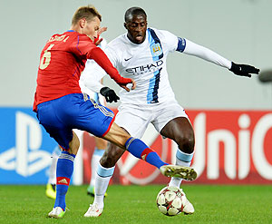 Aleksei Berezutski (L) of PFC CSKA Moscow in action against Yaya Toure of Manchester City FC during the UEFA Champions League Group D match on Wednesday