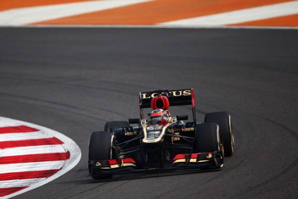 Kimi Raikkonen of Finland and Lotus drives during practice on Friday