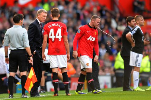 Manchester United's Wayne Rooney with coach David Moyes