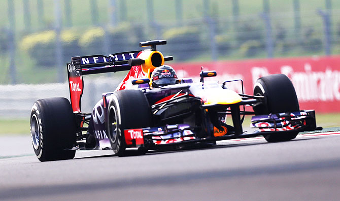Red Bull Formula One driver Sebastian Vettel of Germany drives during the first practice session of the Indian F1 Grand Prix at the Buddh International Circuit in Greater Noida on Friday