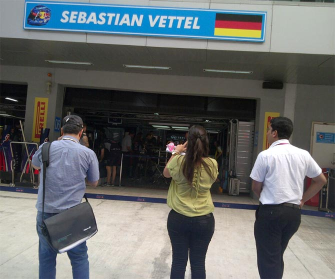 Fans outside Sebastian Vettel's pit garage