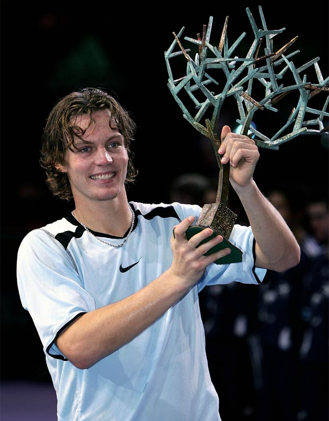 Tomas Berdych of the Czech Republic holds aloft the trophy after his five set victory against Ivan Ljubicic of Croatia in the final