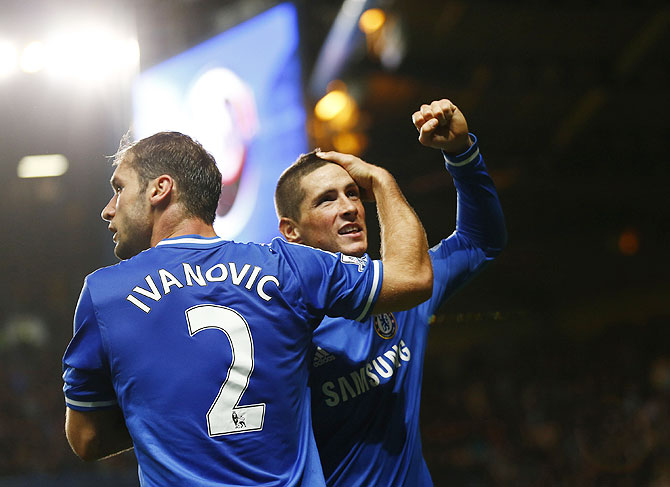 Chelsea's Fernando Torres (rights) celebrates with teammate Branislav Ivanovic after scoring a goal against Manchester City during their English Premier League match at Stamford Bridge in London on Sunday