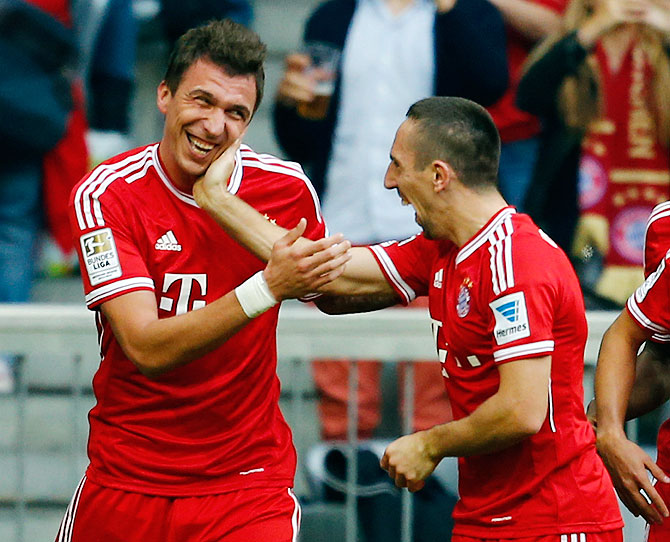 Mario Mandzukic (left) and Franck Ribery of FC Bayern Munich celebrate a goal during their Bundesliga match against Hertha Berlin in Munich on Sunday