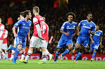 Juan Mata celebrates his goal against Arsenal with teammates during their FA Cup match on Tuesday
