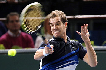 Richard Gasquet of France returns a shot to Fernando Verdasco of Spain at the Paris Masters men's singles tennis tournament on Tuesday