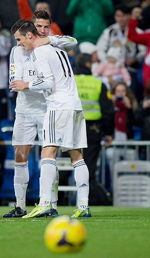 Real Madrid's Gareth Bale and Cristiano Ronaldo celebrate a goal against Sevilla on Wednesday