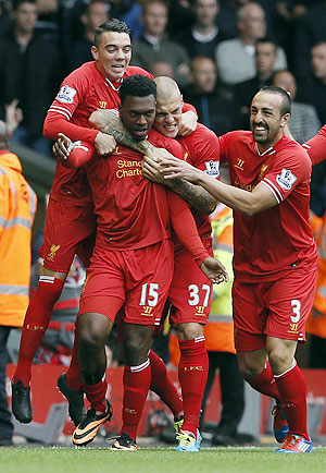 Liverpool players celebrate with Danny Sturridge after a goal against Manchester United on Sunday