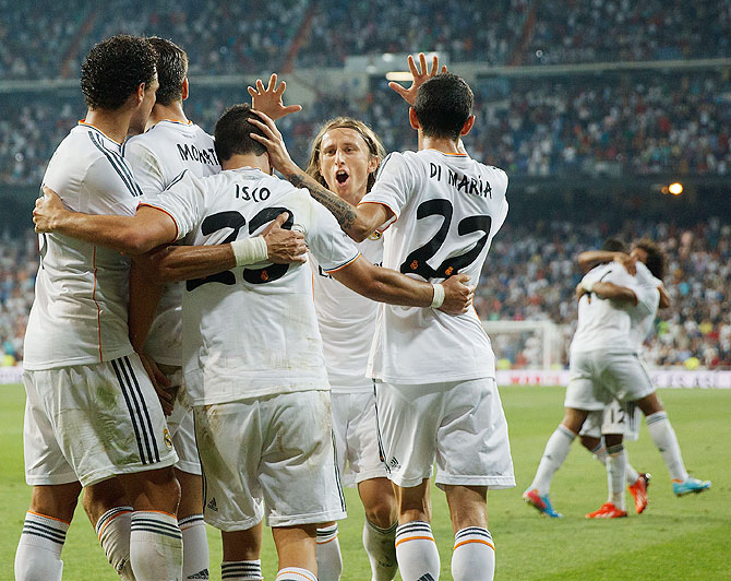 Luka Modric celebrates with teammates after Isco's second goal on Saturday