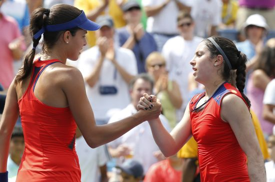 Ana Ivanovic (L) of Serbia is congratulated by Christina McHale of the U.S. after her victory