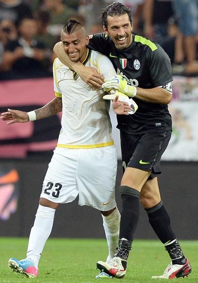 Arturo Vidal and Gianluigi Buffon of Juventus FC celebrate