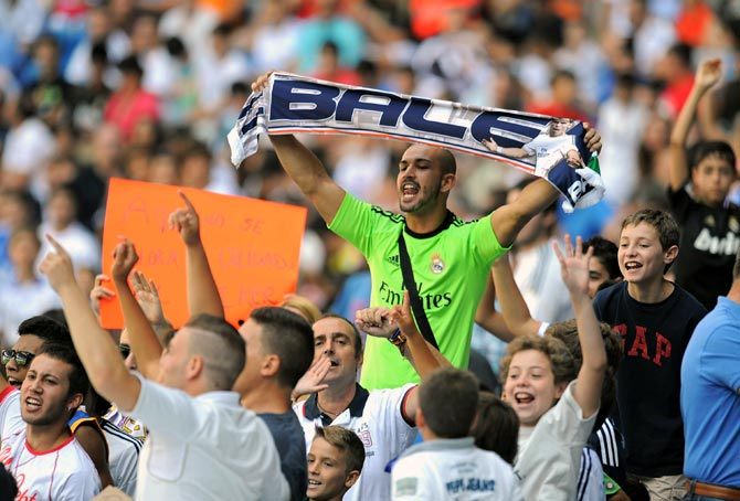 Real Madrid fans cheer during the official unveiling of Gareth Bale at Santiago Bernabeu in Madrid