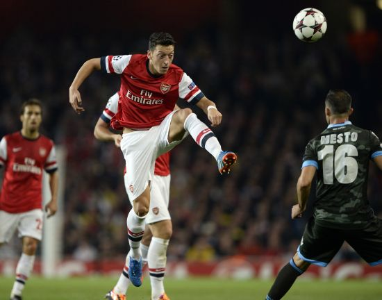 Arsenal's Mesut Ozil (C) controls the ball during their Champions League soccer match against Napoli