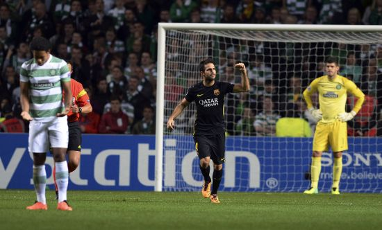 Barcelona's Cesc Fabregas (C) celebrates after scoring during their Champions League soccer match against Celtic