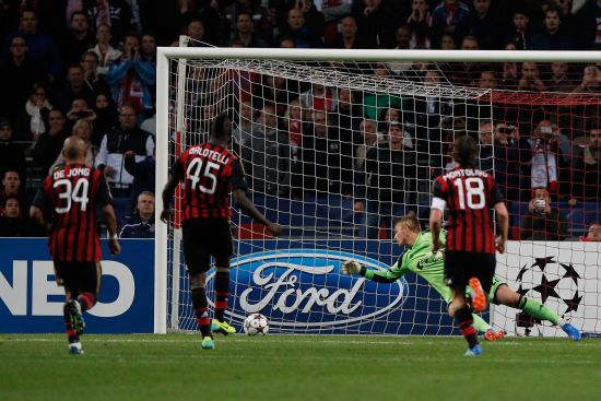 Mario Balotelli of AC Milan takes and scores a penalty on the last minute during the UEFA Champions League Group H match between Ajax Amsterdam and AC Milan