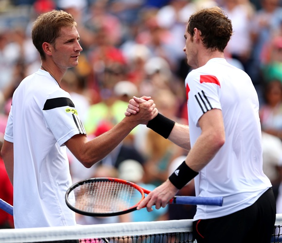 Andy Murray of Great Britain shakes hands at the net with Florian Mayer of Germany
