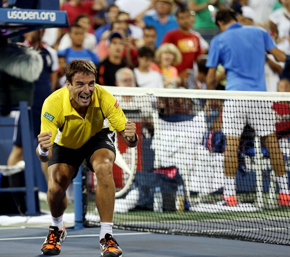 Tommy Robredo of Spain reacts after defeating Roger Federer