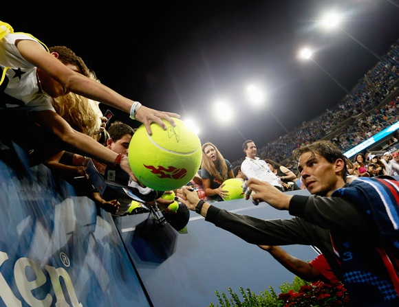 Rafael Nadal of Spain signs autographs for fans