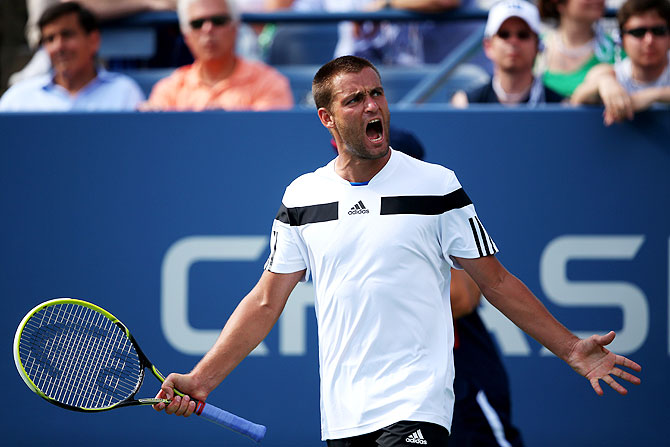 Mikhail Youzhny of Russia celebrates a point during his men's singles fourth round match against Lleyton Hewitt of Australia on Tuesday