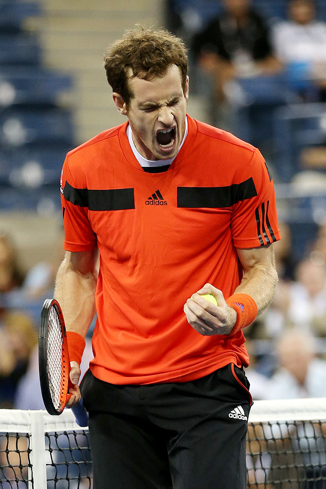 Andy Murray of Great Britain celebrates match point to win his men's singles fourth round match against Denis Istomin of Uzbekistan on Tuesday