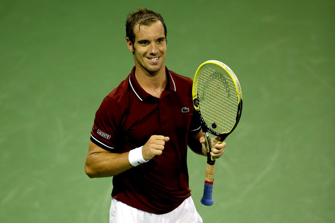 Richard Gasquet of France celebrates match point against Milos Roanic of Canada during their fourth round match