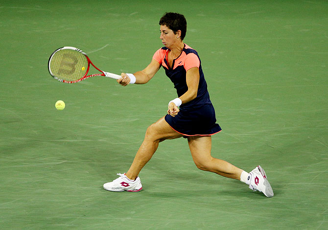 Carla Suarez Navarro plays a forehand against Serena Williams on Tuesday