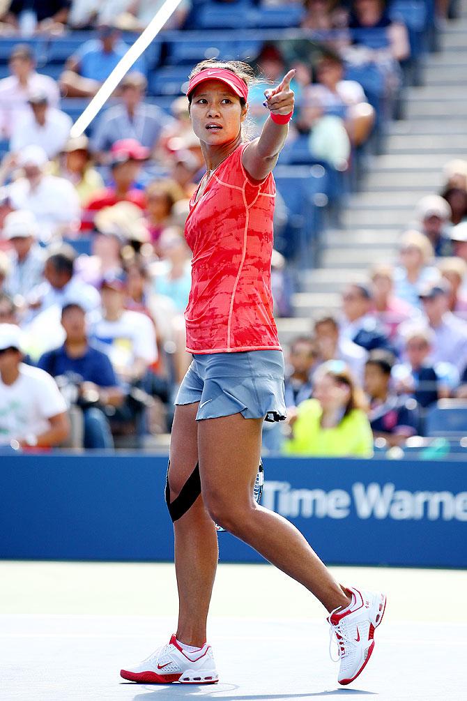 Na Li of China reacts during her women's singles quarter-final match against Ekaterina Makarova of Russia