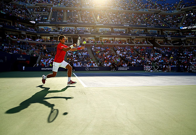 Novak Djokovic of Serbia plays a forehand during his men's singles fourth round match against Marcel Granollers of Spain on Tuesday