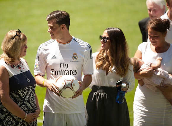 Gareth Bale (centre) is accompanied by his mother Deborah   Bale, girlfriend Emma-Rhys Jones, daughter Alba Bale (in arms)