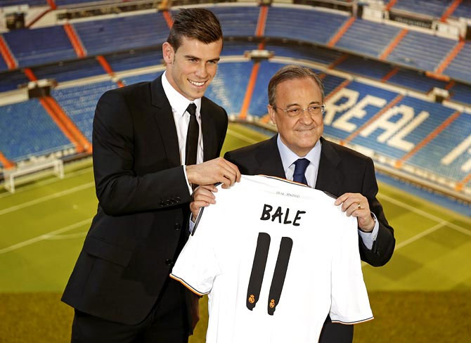 Gareth Bale (left) with Real Madrid president Florentino Perez