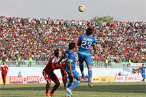 India's Robin Singh and Syed Rahim Nabi challenge a Nepal defender as they threaten the rival goal during their SAFF Cup match at Kathmandu on Thursday