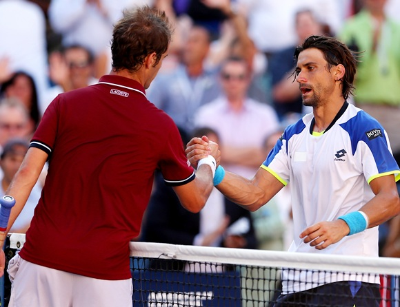 Richard Gasquet of France shakes hands at the net with David Ferrer of Spain
