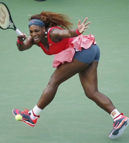 Serena Williams of the plays a forehand