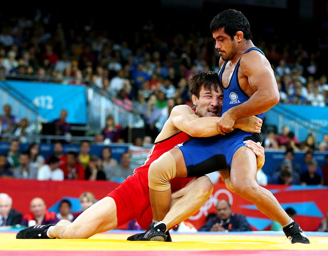 Sushil Kumar of India in action against Akzhurek Tanatarov of Kazakhstan during the men's freestyle wrestling 66kg semi-final bout at the London 2012 Olympic Games