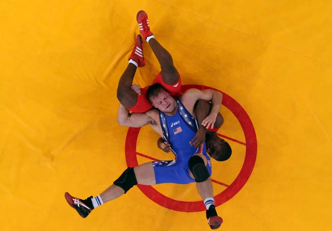 Jake Herbert of US (blue) in action against Humberto Daniel Arencibia Martinez of Cuba