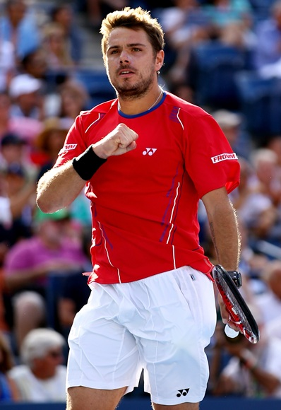 Stanislas Wawrinka of Switzerland celebrates match point