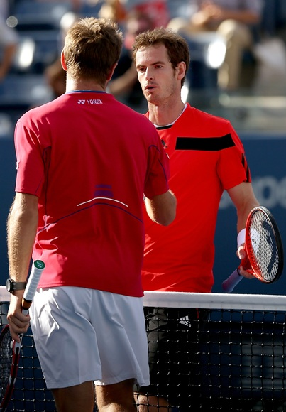 Stanislas Wawrinka shakes hands at the net with   Andy Murray