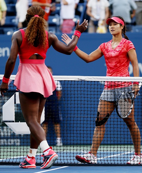 Serena Williams of United States of America shakes hands at the net with Na Li of China