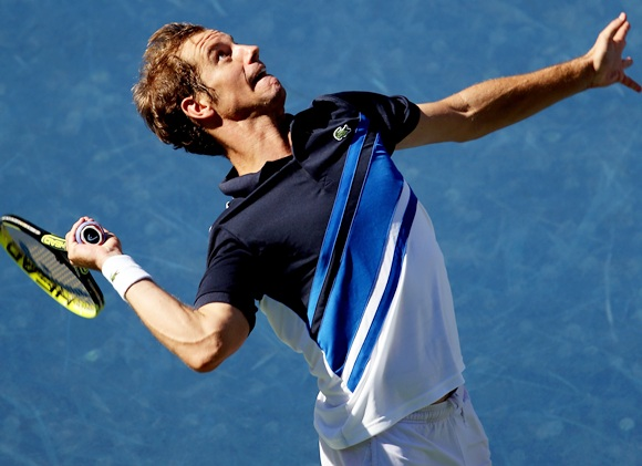 Richard Gasquet of France serves