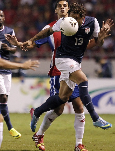 Jermaine Jones (front) of the US heads the ball against Costa Rica's Bryan Ruiz