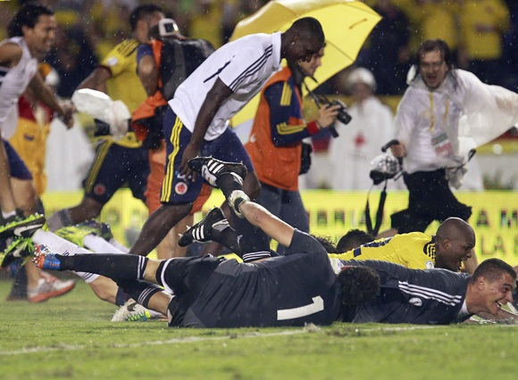 Colombia's team members celebrate after defeating Ecuador