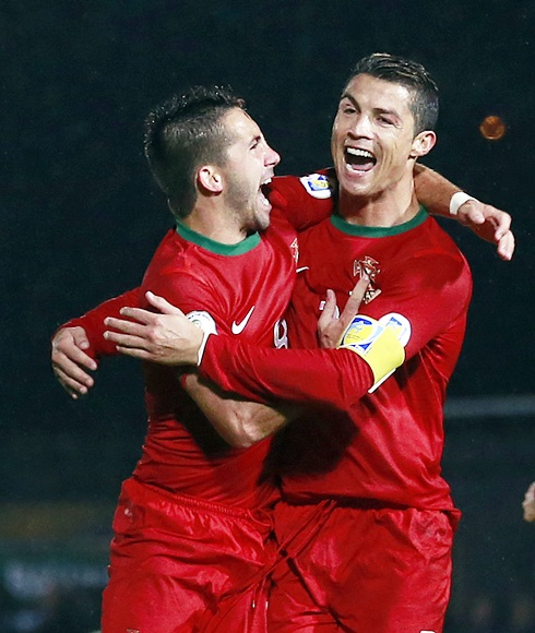 Portugal's Cristiano Ronaldo celebrates with teammate Joao Moutinho