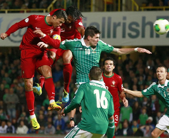 Portugal's Cristiano Ronaldo (left) heads a goal against Northern Ireland