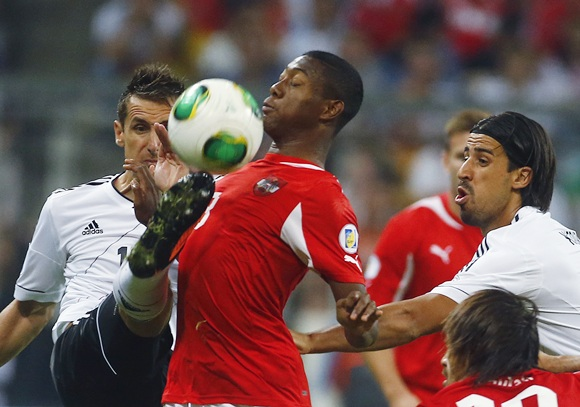 Germany's Miroslav Klose (left) and Sami Kedhira challenge Austria's David Alaba