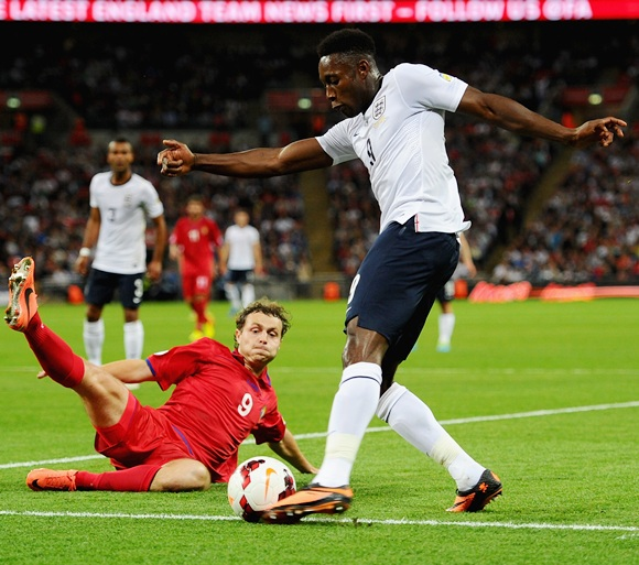 Alexsandru Antoniuc of Moldova goes into block an effort from Danny Welbeck of England