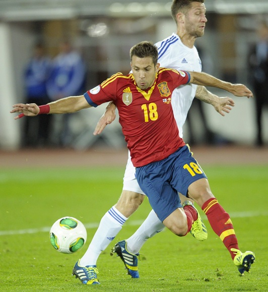 Spain's Jordi Alba (front) dribbles past Finland's Joona Toivio to score