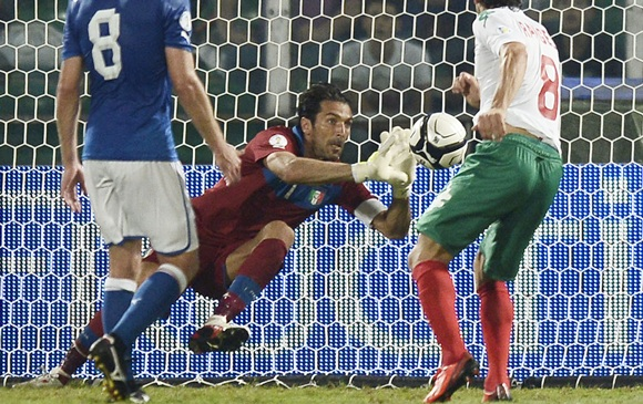 Italy's goalkeeper Gianluigi Buffon (centre) makes a save