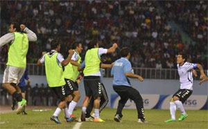 Afghan players celebrate after winning the match against Nepal on Sunday