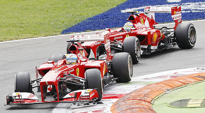 Ferrari Formula One driver Fernando Alonso of Spain drives ahead of teammate Felipe Massa of Brazil during the Italian F1 Grand Prix on Sunday